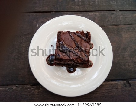 Stock Photo Delicious chocolate brownies on white plate.