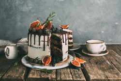 Delicious chocolate cake with figs and blackberries on a rustic background