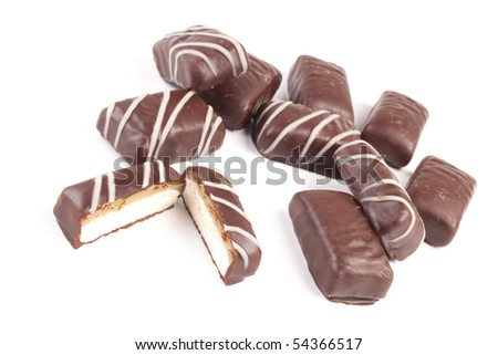 Delicious chocolate confettis on a white background