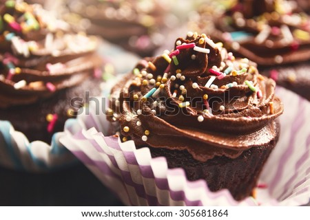 Delicious chocolate cupcakes with rich cream on the top