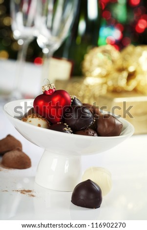 Delicious chocolate pralines and truffles with Christmass heart
