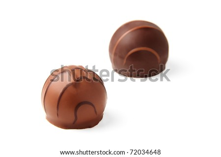 Delicious chocolate pralines isolated on white background