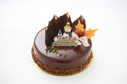 Delicious Christmas chocolate cake with snowman