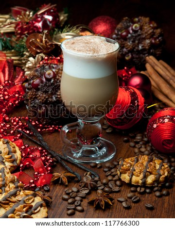 Delicious christmas coffee with spices and decoration