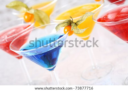 Delicious coctails garnished with fruits