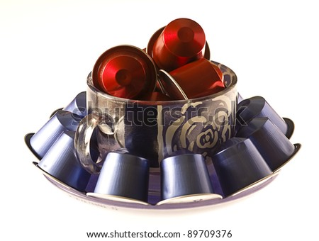 delicious coffee capsules isolated on a white background