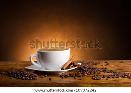 delicious coffee on wooden table on dark background