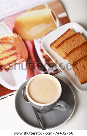 Delicious coffee with milk and biscuits