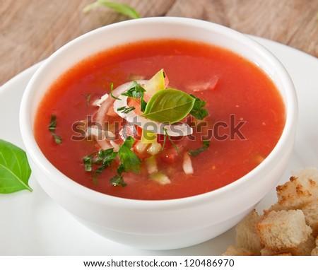 delicious cold Gazpacho soup in white bowl