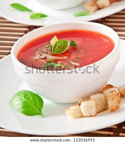 delicious cold Gazpacho soup in white bowl