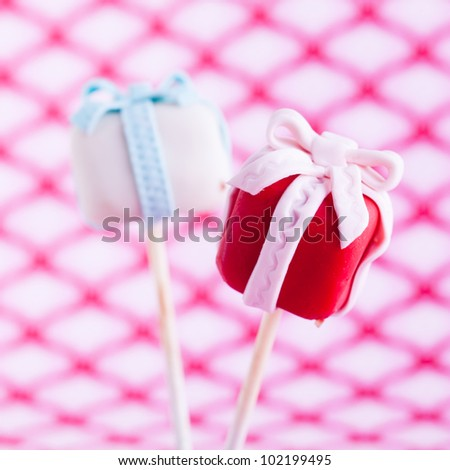 Delicious coluored Cake pop as a gift with a trendy background - stock photo