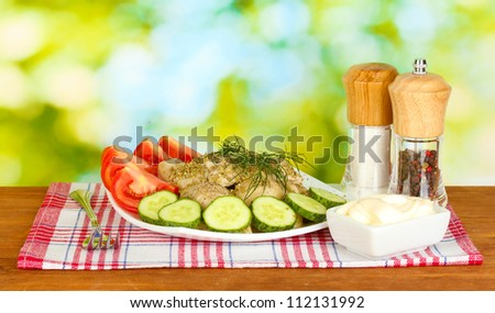 Delicious cooked dumplings with vegetables in the dish on bright green background - stock photo