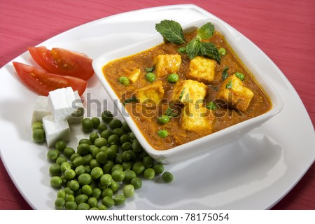 Delicious cottage cheese cooked with peas with Ingredients - stock photo
