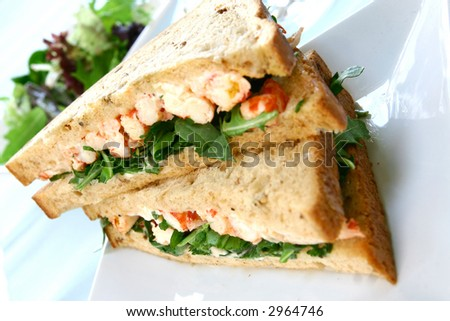 Delicious crayfish/king prawn sandwich on malted bread and mayonnaise on fresh rocket