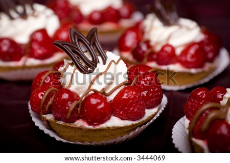 Delicious cream cake with raspberries and chocolate and whipped cream