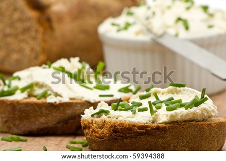 Delicious cream cheese on fresh sliced bread with chives