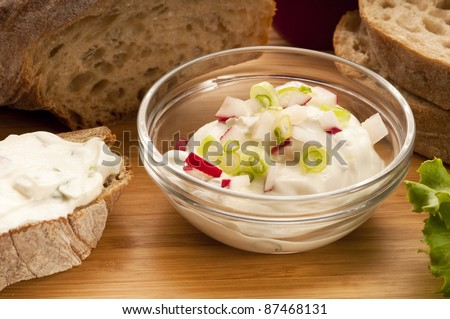 Delicious cream cheese with chives and vegetables - stock photo