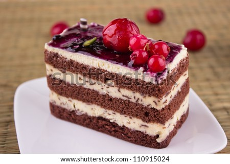 Delicious cream chocolate cake with cherry