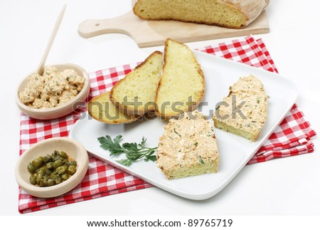 "Delicious cream ""liptauer"" cheese on fresh sliced bread with chives and parsley"
