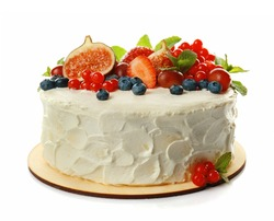 Delicious creamy cake with berries isolated on white