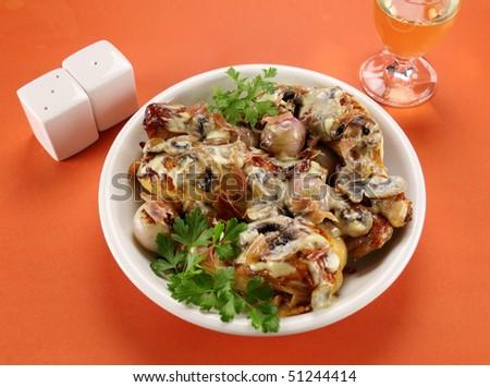 Delicious creamy mushroom chicken with flat leaf parsley.