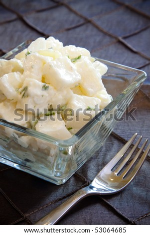 Delicious creamy potato salad dressed in mayo infused with parsley.