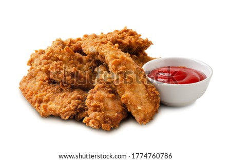 Delicious crispy fried chicken breast strips with tomato sauce isolated on a white background