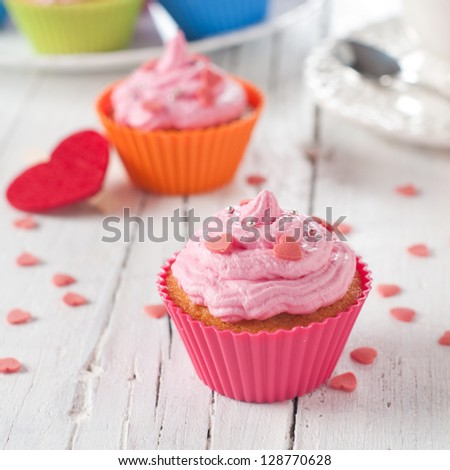 Delicious cupcake on the wooden table