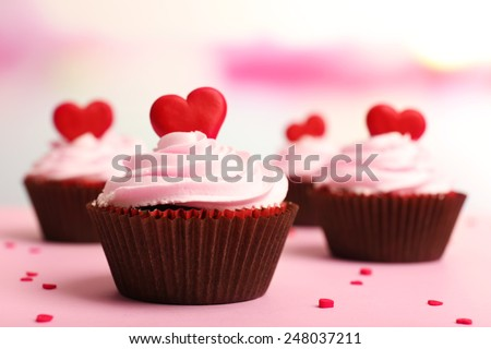 Delicious cupcakes for Valentine Day on bright background