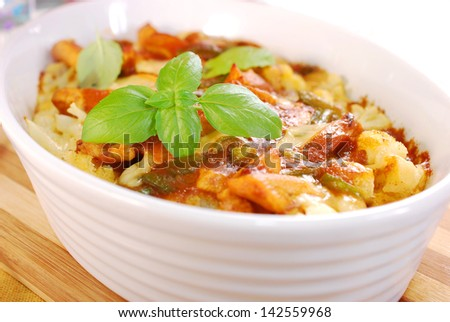 delicious curry chicken casserole with cauliflower, potato,green paprika and eggs