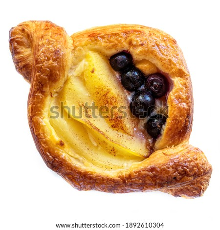 Delicious Danish pastry with apple and blueberries, isolated on white background.  Top view. Stockfoto ©