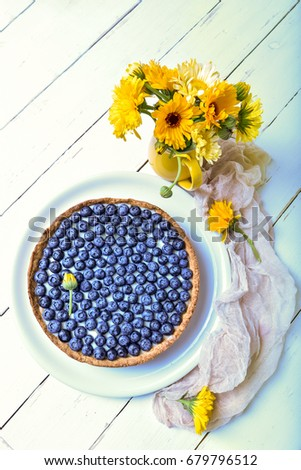 Delicious dessert blueberry tart with fresh berries, sweet tasty cheesecake, berry, bog bilberry, whortleberry pie. French cuisine