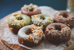 Delicious donuts cooked with natural sweetener.Doughnuts with no sugar prepared for lunch in bakery.Sweet dessert food baked in pastry cafe for breakfast.Enjoy tasty glazed desserts donut with coffee