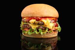 Delicious double cheeseburger with melted cheese and lettuce on a fried crispy bun.