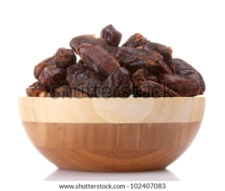 delicious dried dates in wooden bowl isolated on white
