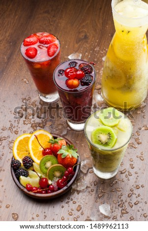 delicious drinks and cold drinks of colorful tropical fruits