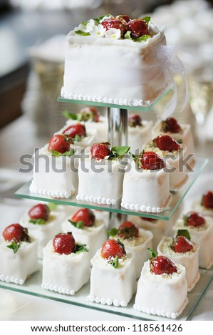 Delicious fancy wedding cake made of cupcakes - stock photo