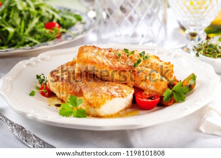 delicious fillets of grilled or oven baked pollock or coalfish served with a fresh salad