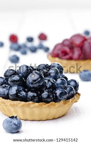 Delicious flan - cupcake with fresh blueberry and raspberry