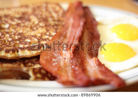Delicious French toast with bacon and eggs for breakfast.