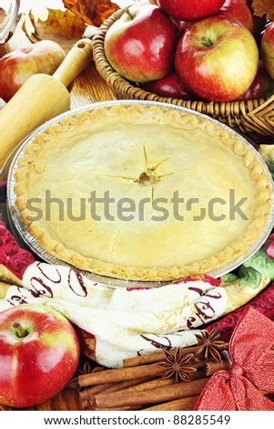 Delicious fresh baked apple pie with ingredients. Perfect for the holidays.