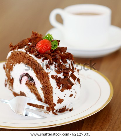 Delicious fresh baked chocolate cake with a cup of coffee