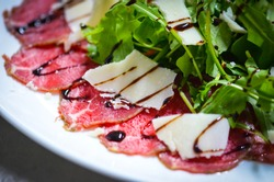 delicious fresh bresaola with tasty ruccola