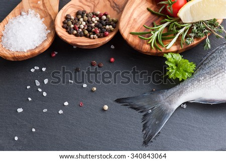 Delicious fresh fish on dark vintage background.  healthy food, diet or cooking concept