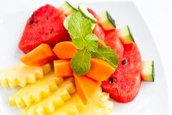 Delicious fresh fruit on white plate