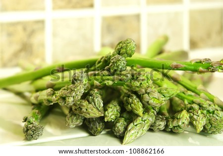 Delicious fresh green asparagus spears with copy space.