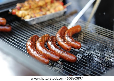 Delicious fresh grilled sausages ready to serve