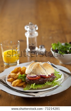 Delicious fresh hamburger with fries and tomato