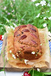 Delicious fresh homemade banana bread with pecans on the top