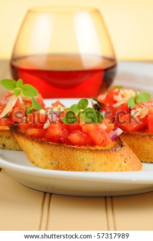 Delicious fresh homemade bruschetta on small toasts.